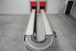 Cerramientos cortafuegos de cintas transportadoras  y sistemas de transporte